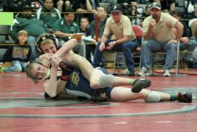 Paonia 113-pounder Josh Altman controls Olathe's Austin Shank at the 35th annual Warrior Classic at Central High School.