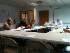 Ken Nordstrom (left) delivers a proposal for proactive aerial mosquito spraying in western Delta County.