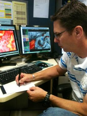 Norvan Larson, Forecaster at the National Weather Service Forecasting Office in Grand Junction