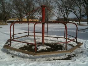 Delta County purchased new playground equipment for the Fairgrounds using $7400 in Conservation Trust funds, not yet installed. An old merry-go-round clearly has seen better days.