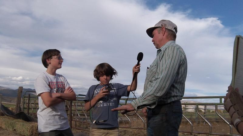 Agriculture reporters, Will Ela and Isaac VanHorn, interview local rancher, Norm Smith.