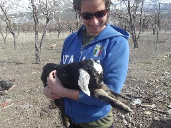 Emily with one of her newly born goats.