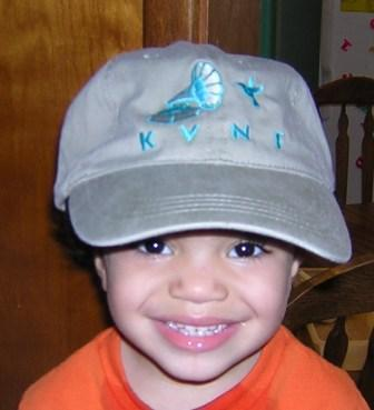 The KVNF baseball style cap for a $50 pledge (Beautiful child not included)