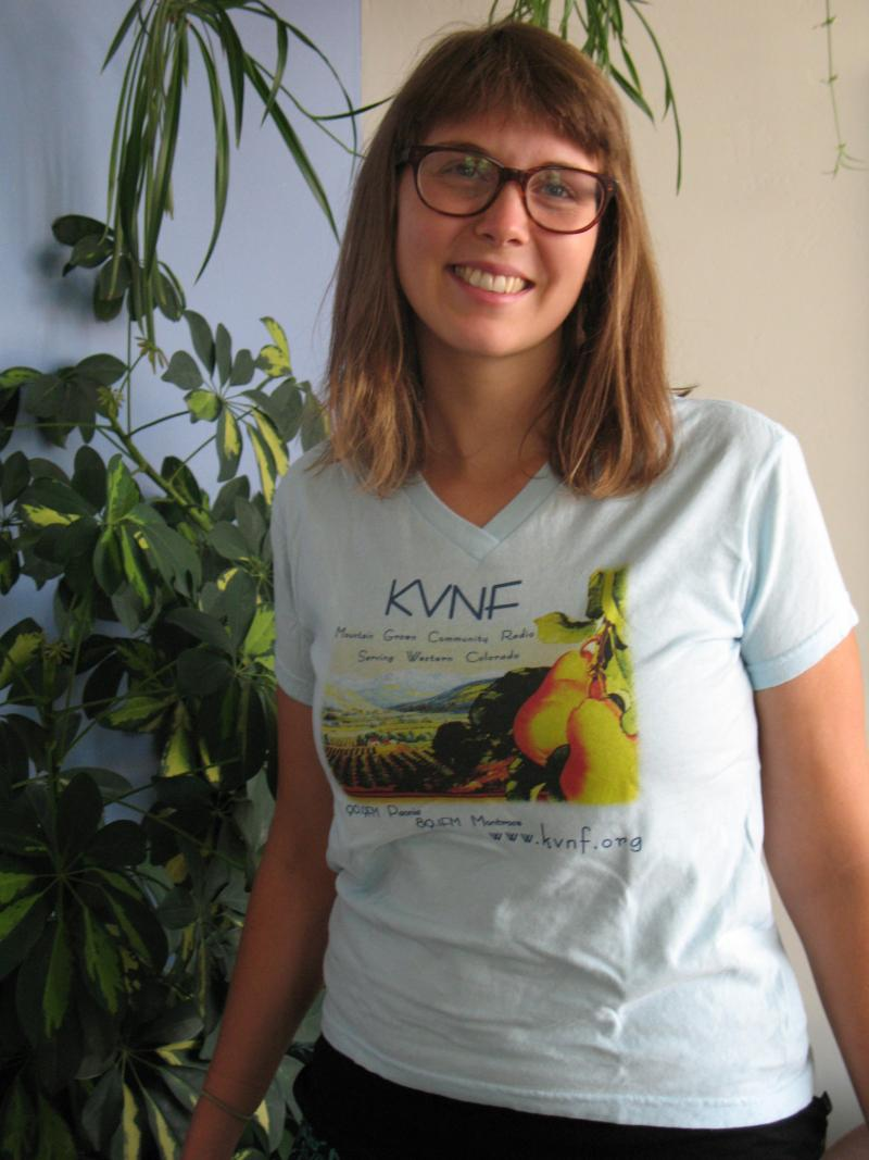 Light blue wome'n's cut t-shirt with newly re-designed KVNF fruit labe logo. (Modeled by our lovey KVNF DJ Joanna Calabrese)