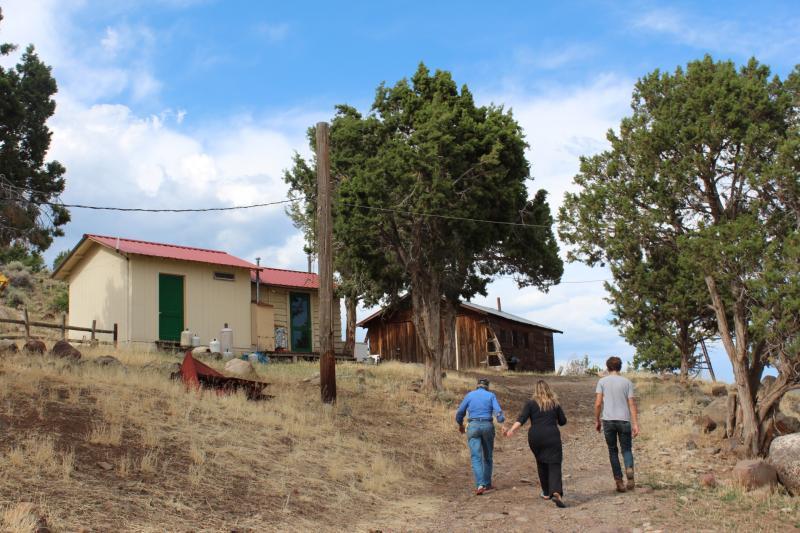 Karla Tschoepe, Ali Lightfoot and Travis Bubenik walk up to Karla's bunk house on Stucker Mesa
