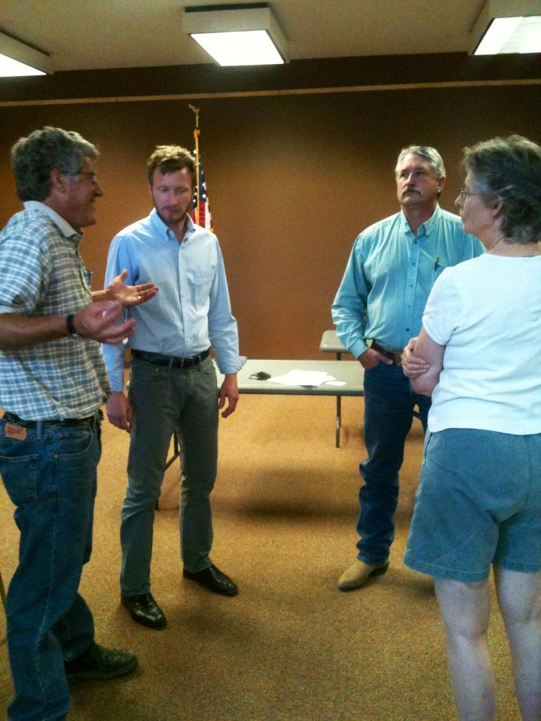 Grant Colvin speaks with community members. Pictured (L-R) Steve Ela of Ela Family Farms, Grant Colvin, Delta County Commissioner Mark Roeber