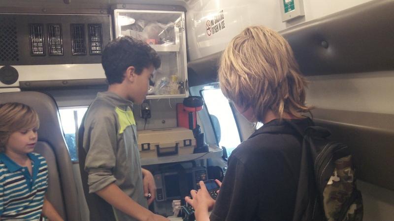 Noah, Eden and Mason check out the equipment