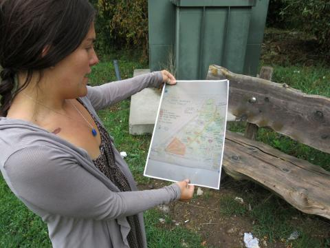 Stephanie Syson of the Central Rocky Mountain Permaculture Institute looks at plans for a proposed food forest in Basalt, Colo.