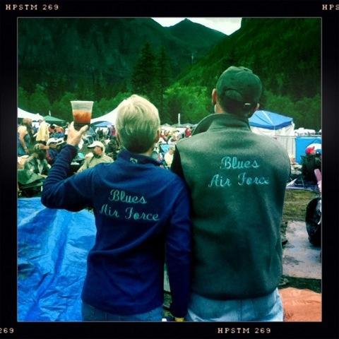 Back of Women's Fleece Quarter Zip shirt and Men's Fleece Vest