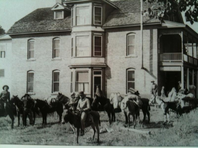 A survey team leaves the Bross Hotel, around 1913