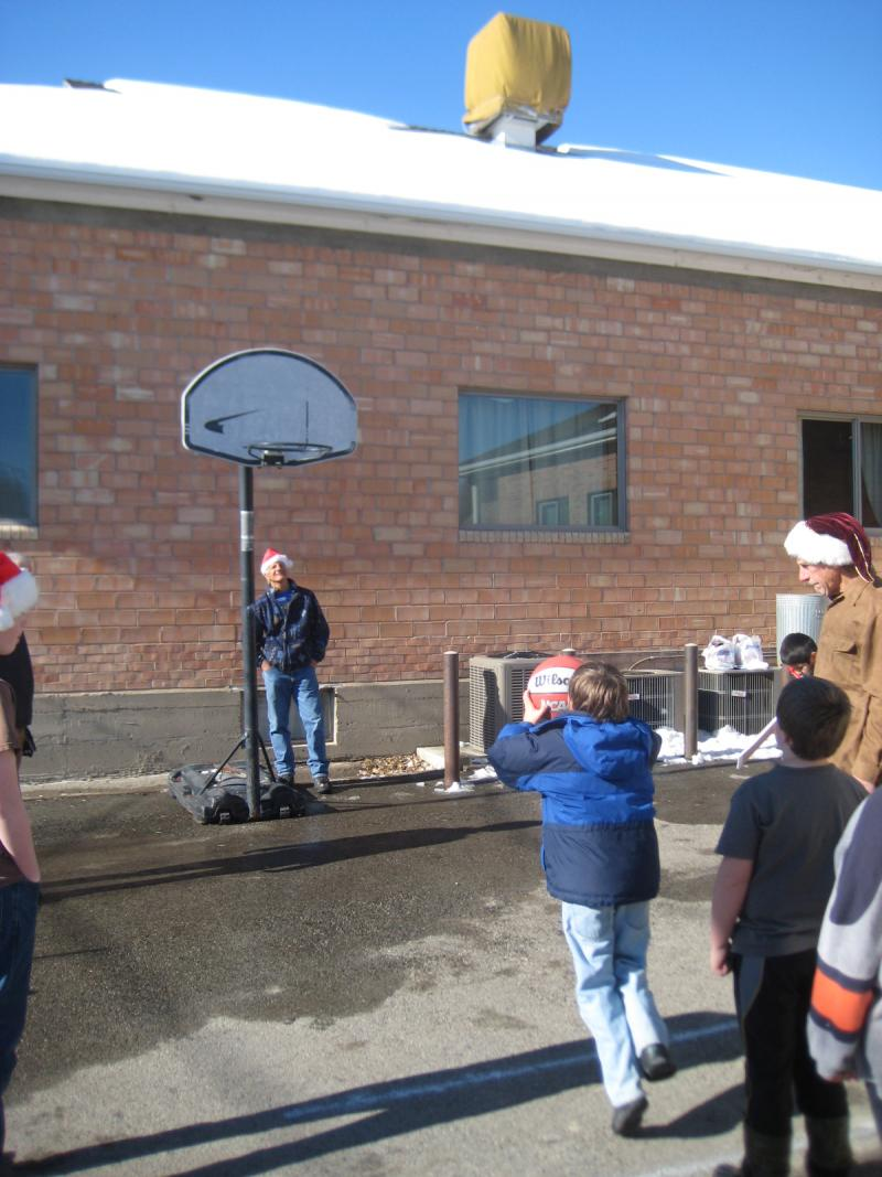 Kids shoot hoops for a prize.