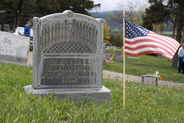 A flag left at the grave of a veteran laid to rest in Crawford, CO.