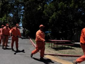 Prison inmates assist Calfire crews in fighting a blaze