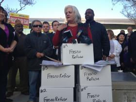 Marina Magdaleno and other outsourcing opponents rallied in front of Fresno City Hall Friday Jan. 18 to turn in just under 40,000 petitions to put the decision of outsourcing in the hands of voters.