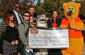 ACEL students pose with the Fresno Grizzlies mascot Parker at the ceremony announcing the launch of the garden program last fall.
