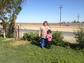 Sandra Garcia, left, of Poplar, can't drink her water because it's contaminated by nitrates.