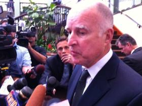 Gov. Jerry Brown speaks with reporters Wednesday afternoon after addressing the California State Association of Counties legislative conference at a Sacramento hotel.