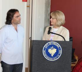 Sevak Kachadurian, owner of the Pacific Southwest Building speaks with Fresno Mayor Ashley Swearengin at a press conference announcing his purchase of the building, September 30, 2011.