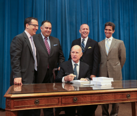 California Governor Jerry Brown signed the state's budget into law today in Sacramento.