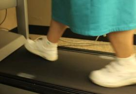 Susan Southard uses a treadmill desk for an hour at her office in El Dorado Hills. She not only walks about 10 miles a week, she also saves money on her health insurance premiums.