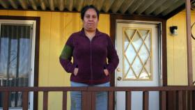Guadalupe Chavez, standing in front of her mobile home, filed one of the few criminal cases by a California farmworker against a farm supervisor for sexual assault.