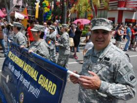 Chief Warrant Officer Mario Garcia, right, joins other members of the California National Guard during the L.A. Pride Parade on June 9, 2013.
