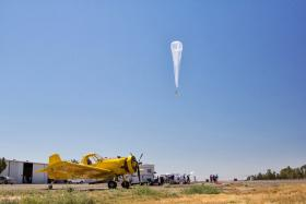 A Project Loon balloon floats over Fresno on July 26, 2013.