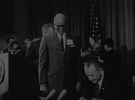 President Lyndon B. Johnson signs the Medicare Bill, July 30, 1965