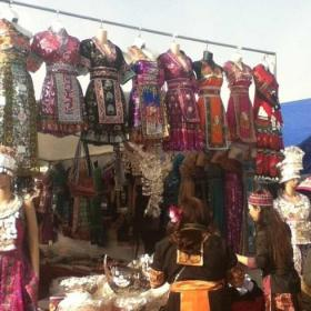 Different designs of traditional Hmong clothes hung up for sale at the Hmong New Years. #iamhmong