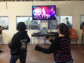 Teenagers at West Side Youth Center practice Zumba daily.