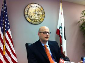 """Governor Jerry Brown's Director of Finance, Michael Cohen, discusses the governor's """"rainy day fund"""" proposal with reporters at the Capitol Wednesday."""