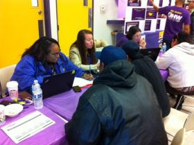 """Uninsured Californians apply for health insurance through the state's federal health care exchange at a union-sponsored """"enroll-a-thon"""" in Sacramento Monday."""