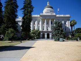 California water managers are selectively watering parts of the state Capitol grounds to preserve historic trees while letting grassy areas dry out.
