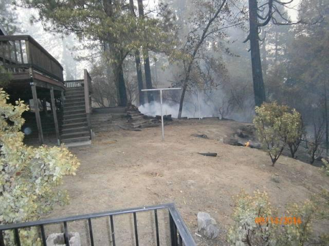 The Courtney Fire burns close to this home near Bass Lake on Sunday September 14th.