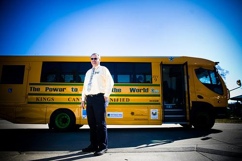 John Clements stands in front of the new E-Trans all-electric school bus that is owned by the Kings Canyon Unified School District in Reedley. (photo courtesy of Kings Canyon Unified)