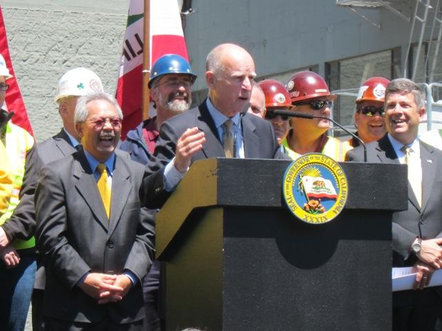 Governor Jerry Brown speaks at a bill-signing ceremony Wednesday at the future site of San Francisco's Transbay Transit Center.