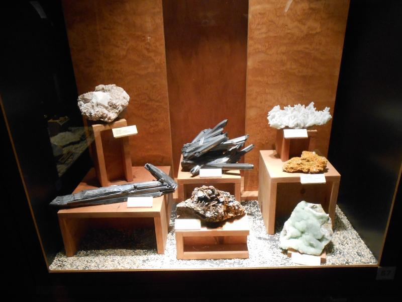 An exhibit of rare minerals is located inside a secure vault at the Mining and Mineral Museum