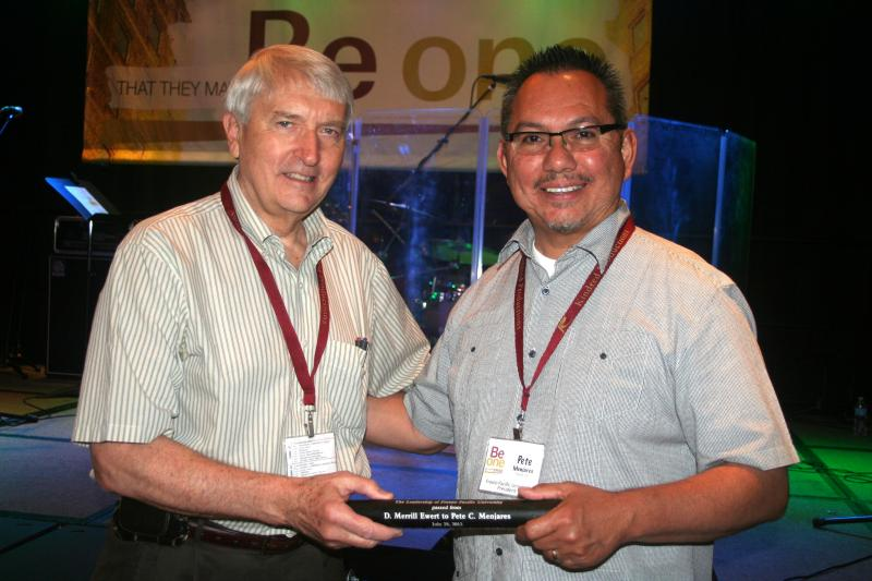 Dr. Merrill Ewert poses with Dr. Pete Menjares at an event in Omaha.