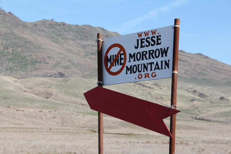 A sign along Highway 180 voices objections to the planned mine on Jesse Morrow Mountain east of Sanger.