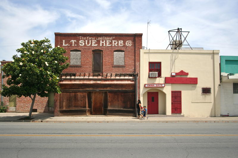 The LT Sue Herb Company building sits boarded up on 7th Street, part of Hanford's China Alley historic district.