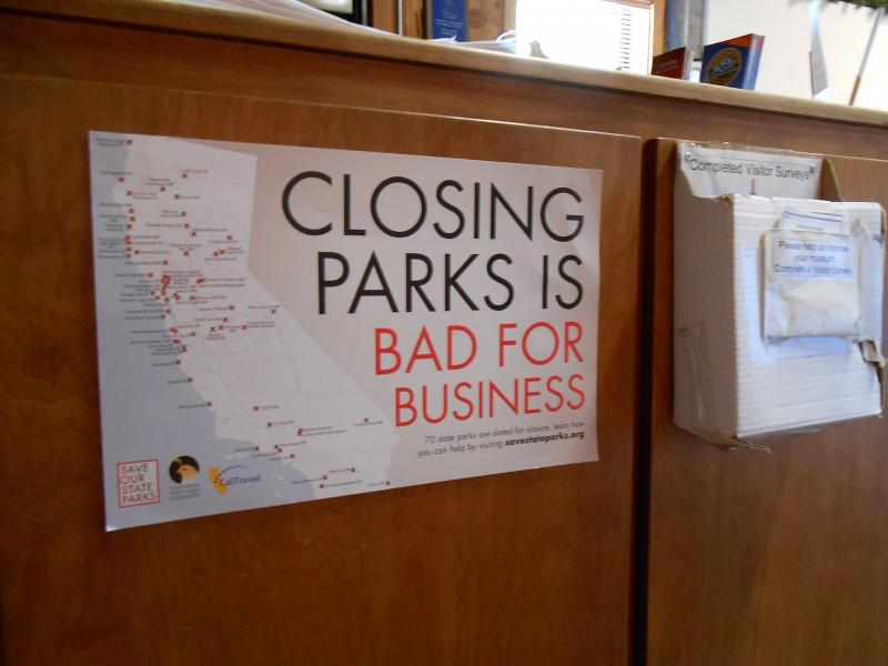 Closing Parks Is Bad for Business reads a sign in the lobby of the California State Mining and Mineral Museum in Mariposa.