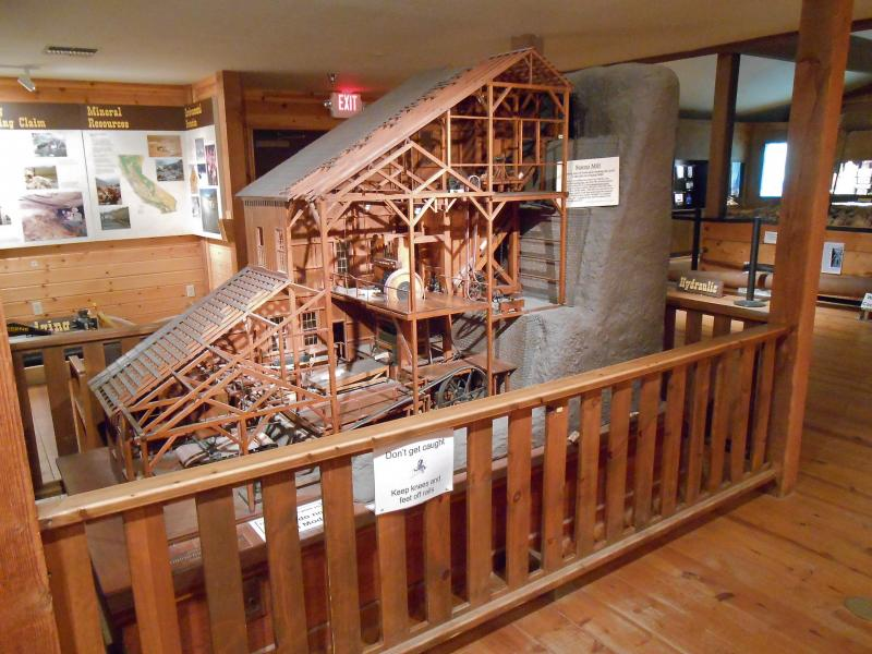 A scale replica of a stamp mill sits inside one of the galleries at the Mining and Mineral Museum in Mariposa.