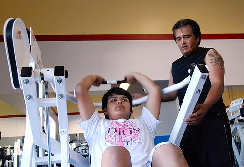 Victor Ycong, 15, works out with his father, Victor Ycong, Senior. The teenager, who is obese has started working out and eating healthier since his Type 1 Diabetes diagnosis in April. He says the diagnosis gave him a second chance at life.