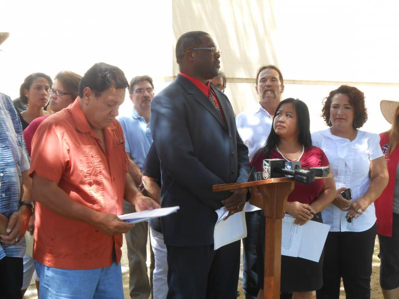 Javier Guzman, Rev. Floyd D. Harris Jr, and Mai Summer Vue speak at a news conference announcing the recall effort