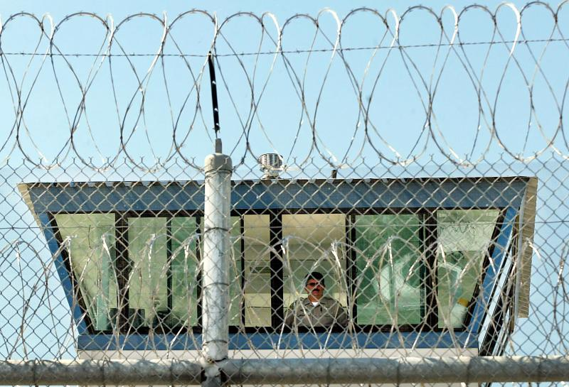 A correctional officer watches from a guard tower seen through the razor wire near Kern Valley State Prison in Delano. The extent of valley fever's under-diagnosis becomes clear when reviewing cases reported by  prisons located in the Central Valley.