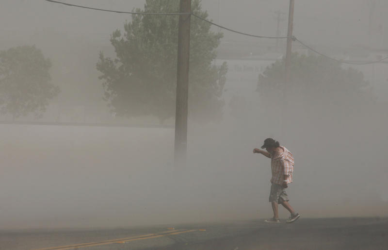 Dust storms like this one that blasted Fresno in June can carry millions of spores from the fungus that causes Valley Fever.