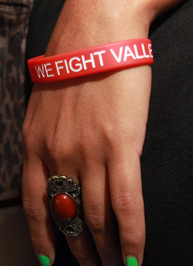 Berenice Parra wears a bracelet used to raise funds for a vaccine to prevent valley fever.