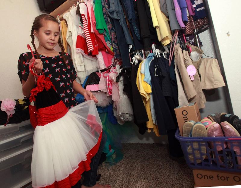 Emily Gorospe, showing off her dance wardrobe, was forced to leave dance lessons after she was diagnosed with valley fever.
