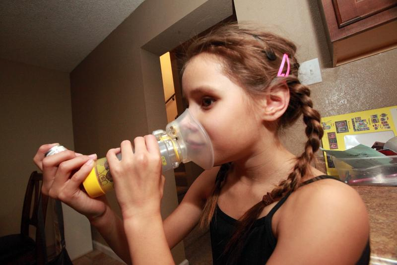 Emily Gorospe uses an inhaler to treat her valley fever with antifungal medication.