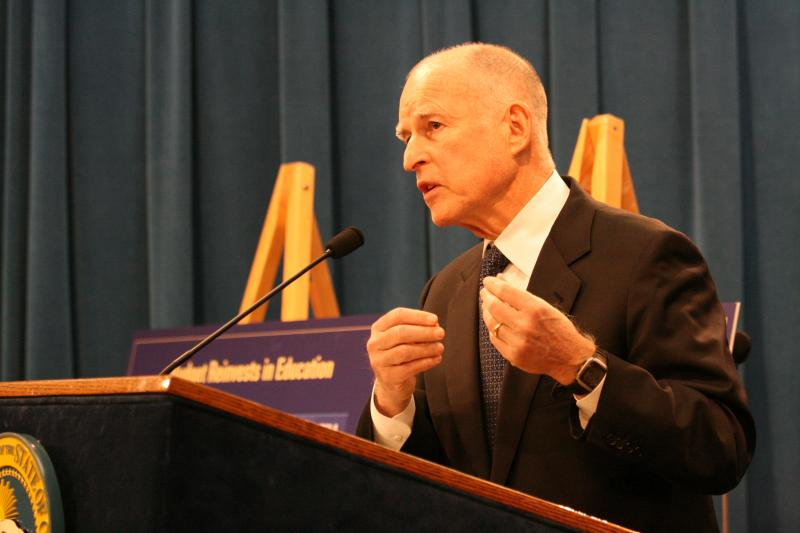 California Governor Jerry Brown speaks to reporters as he unveils his proposed budget.
